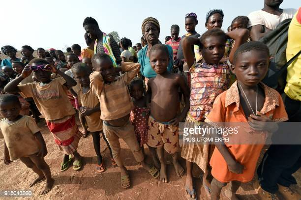 Children look on at the internally displaced people camp occupied largely by women and children affected by herders and farmer's violent clashes from...