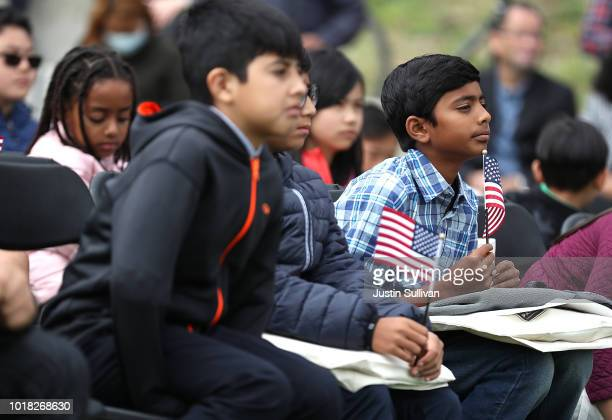 Children look on during a naturalization ceremony for kids between the ages of 612 at Crissy Field near the Golden Gate Bridge on August 17 2018 in...