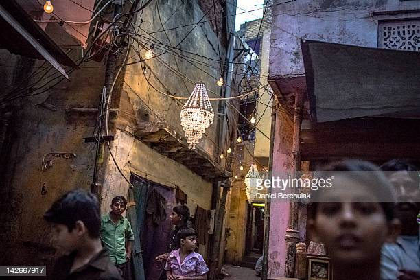 Children look on in a neighbourhood stronghold of the Lok Janshakti Party candidate Akila Begum as she canvases on April 11 2012 in New Delhi India...