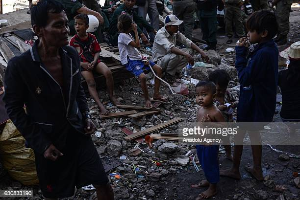 Children look on outside the squatted apartments during a protest at the Borei Keila site in Phnom Penh Cambodia on January 3 2017 Families were...