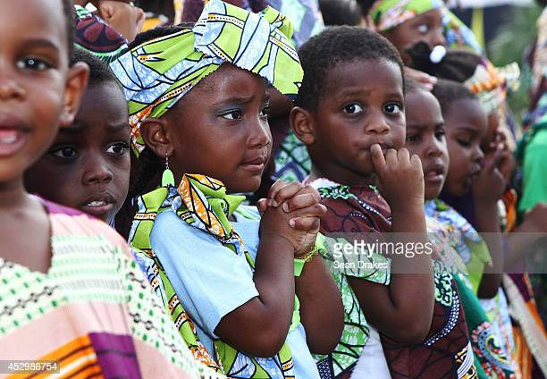 Children look on prior to the visit of education rights activist Malala Yousafzai at the Emancipation Village on July 31 2014 in Port of Spain...