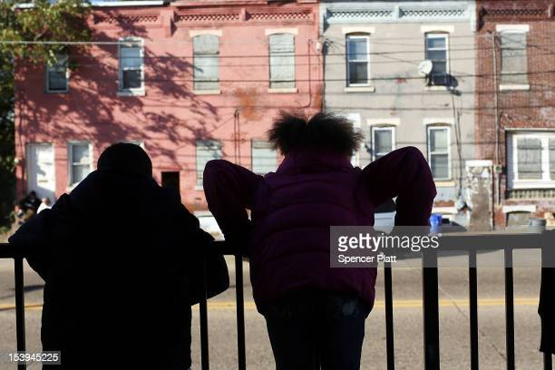 Children look out at homes on October 11, 2012 in Camden, New Jersey. According to the U.S. Census Bureau, Camden, New Jersey is now the most...