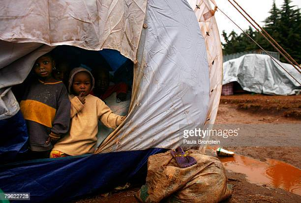 Children look out from a tent at a makeshift internally displaced peoples camp on February 7 2008 in Tigoni Kenya Over 300 thousand people have been...