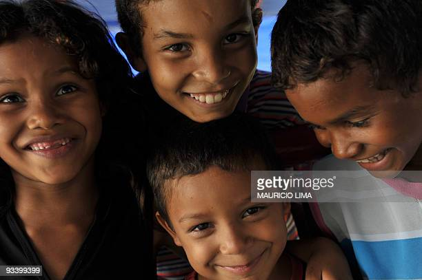 BURLEIGH Children look to the camera while they wait to get medical care on board of Light of the Amazon hospital ship in Mocajuba Island located...