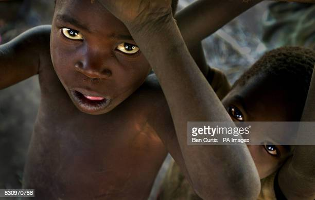 Children look up in the faminestricken village of Kanyopola in central Malawi The United Nations currently estimates 184 million people face...