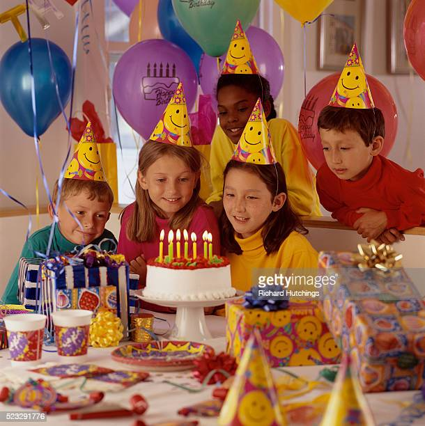 children looking at birthday cake - happy birthday richard stock pictures, royalty-free photos & images