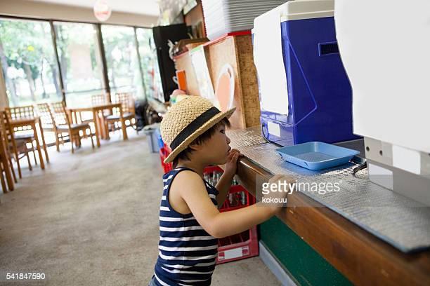 Children looking at the ice of soft-serve ice cream machine