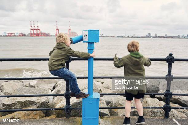 Children looking at the view across a River
