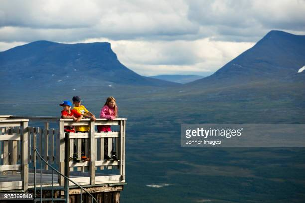 children looking at view - norrbotten province stock photos and pictures