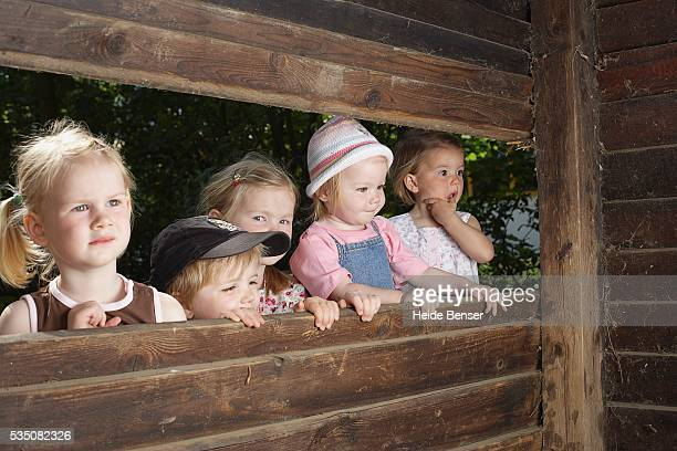 Children looking into playhouse