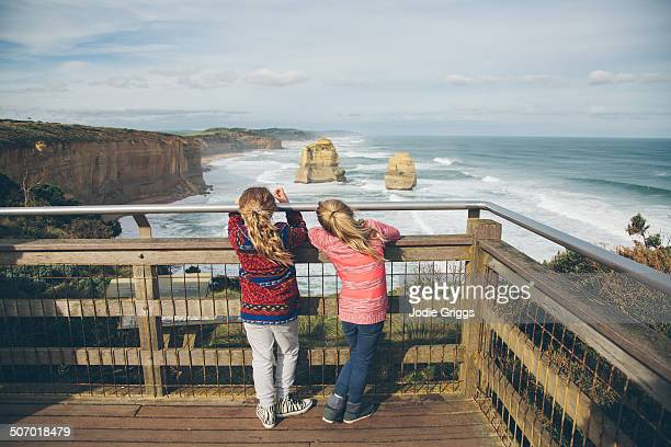 Children looking out at rugged coastline