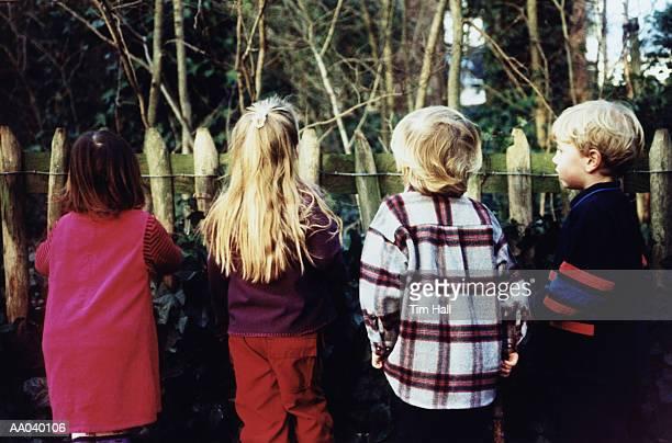 Children Looking Over Fence