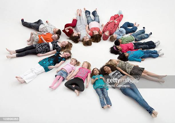 Children lying in a circle.