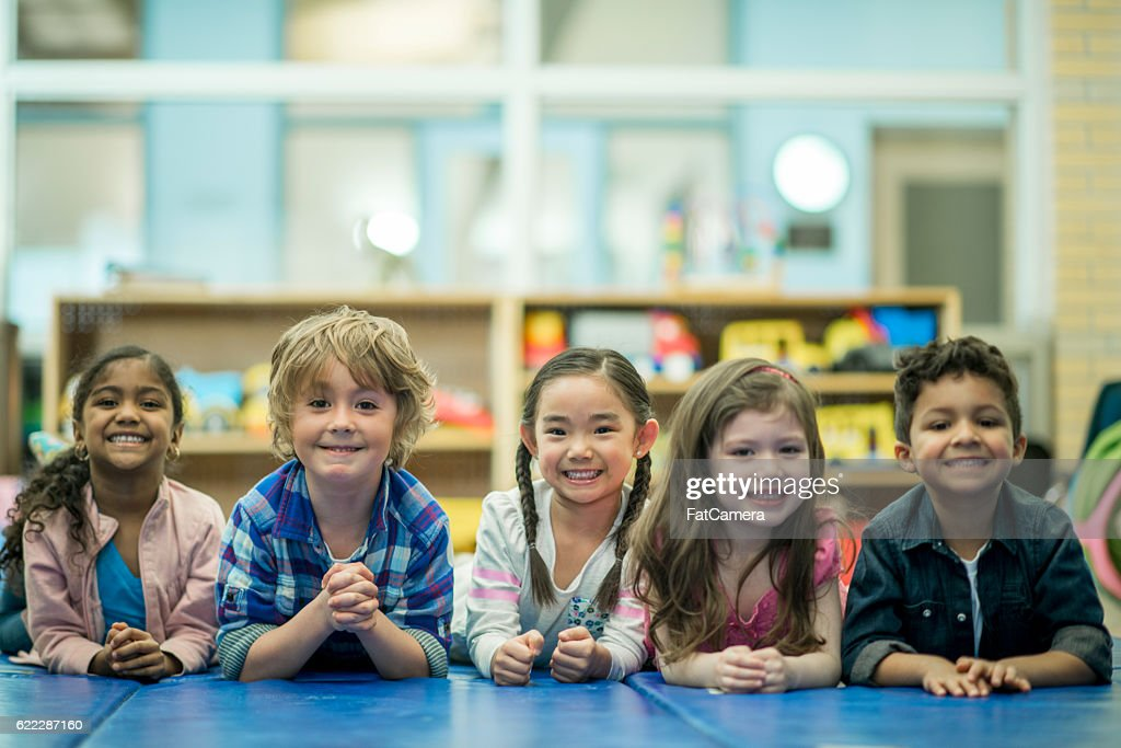 Children Lying in a Row Together : Stock Photo