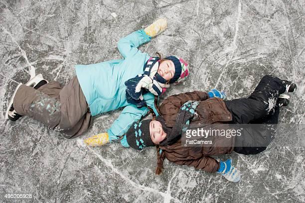 Children Lying on a Frozen Lake