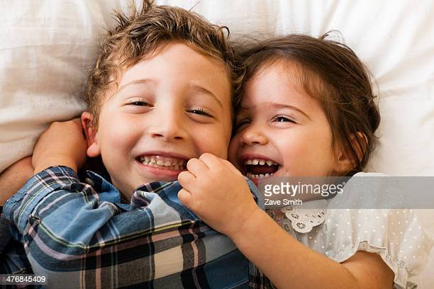 Children lying on bed