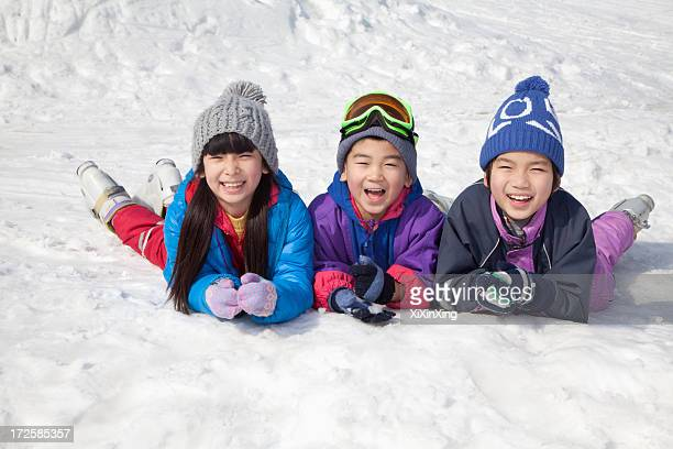 Children Lying on the Snow