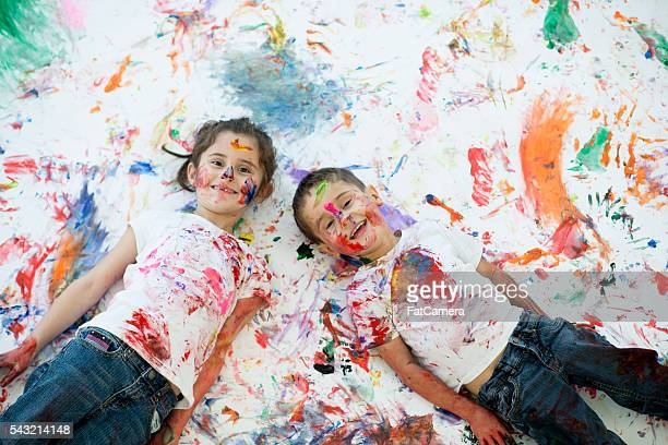 Children Lying on Their Creative Painting
