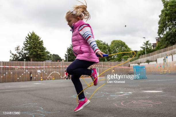 Children maintain social distancing measures as the play in the playground at the Harris Academy's Shortland's school on June 04 2020 in London...