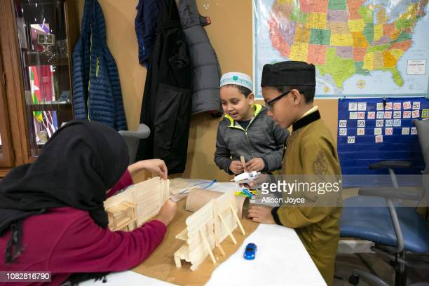 Children make a model of a Native American cabin during homework study at the Rohingya Cultural Center of Chicago on January 11 2019 in Chicago...