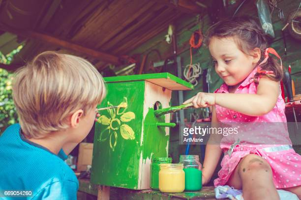 children make and paint birdhouse - birdhouse stock pictures, royalty-free photos & images