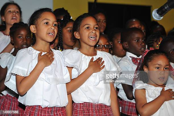 Children make The National Pledge during the Jamaica 50 Flag Raising Ceremony at Jamaica House at O2 Arena on August 6 2012 in London England