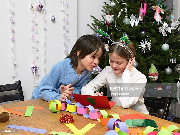 Children making christmas cards and decorations