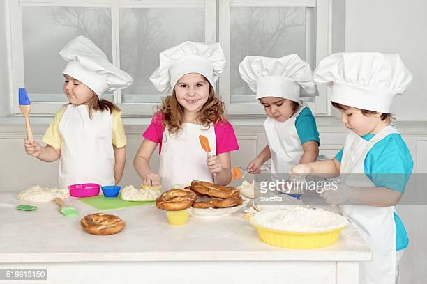 Children Making Dough For Baking