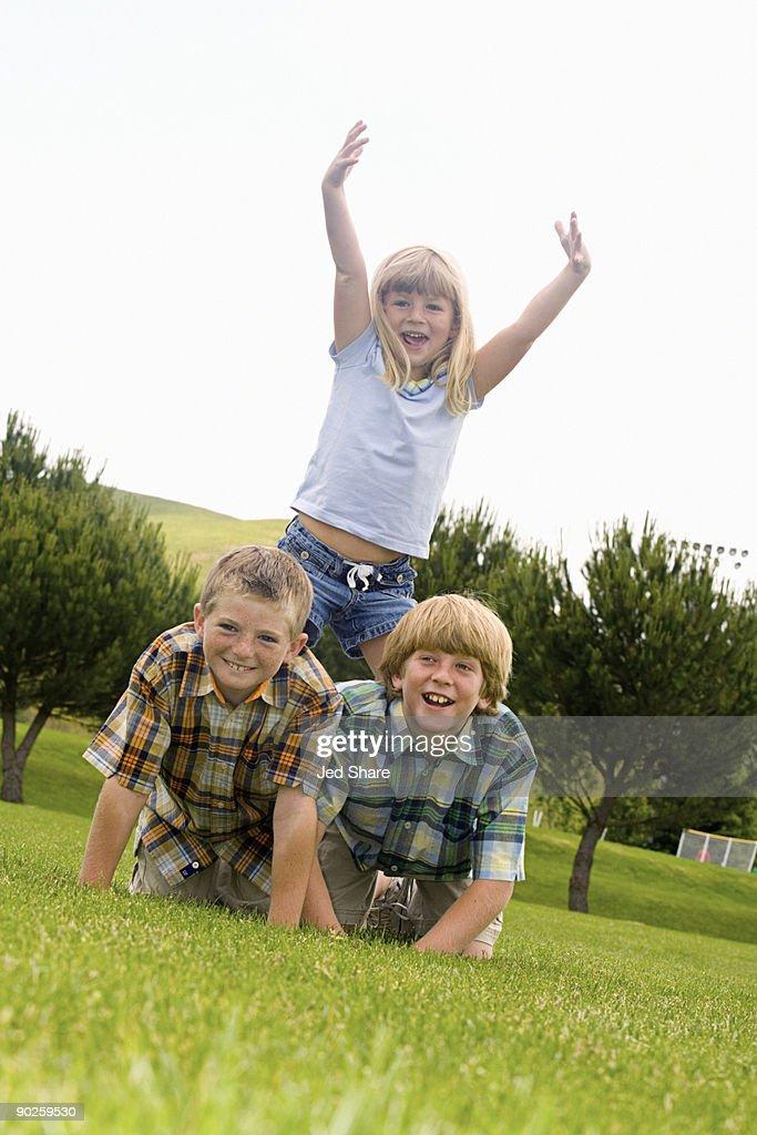 Children making human pyramid : Stock Photo