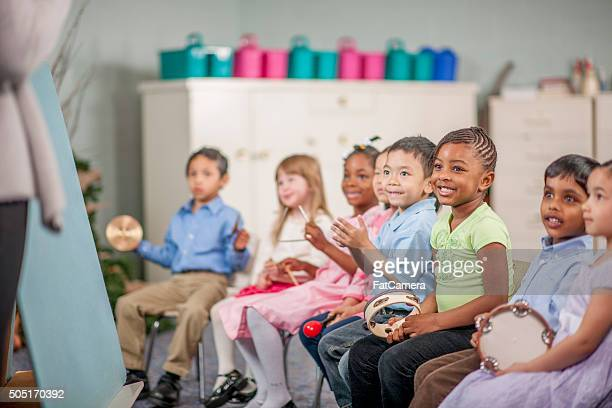 Children Making Music at School