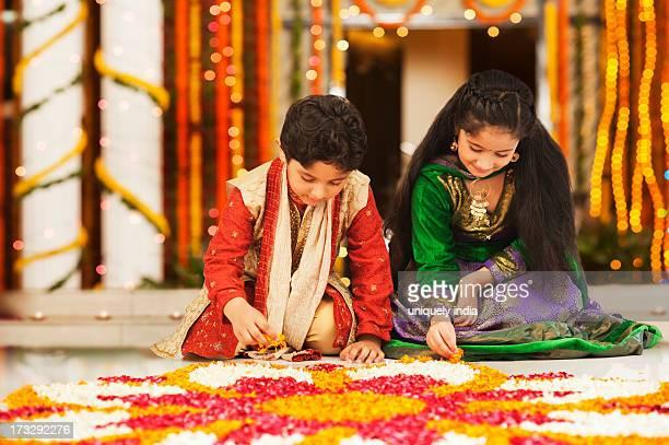 Children making rangoli on Diwali