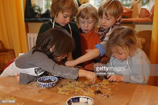 Children making sugar cookies at a kindergarten of the Rudolf Steiner Waldorfschule on December 11 2009 in Berlin Germany Each year Berlin's...
