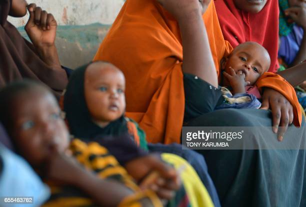 Children malnourished at various levels wait to be processed by aid workers for a UNICEF funded health programme catering to children displaced by...