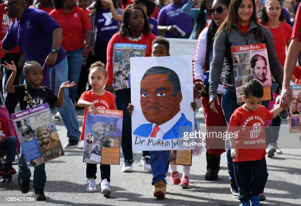 Children march in the annual Dr Martin Luther King Jr Day Parade on January 19 2019 in Orlando Florida