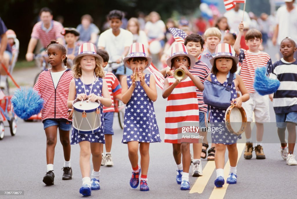 Children marching in 4th of July parade : Stock Photo