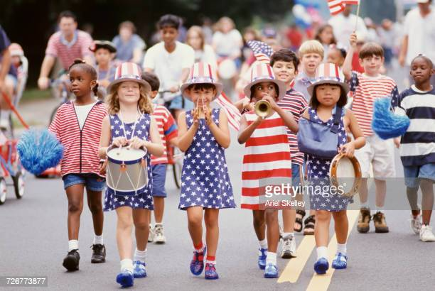 children marching in 4th of july parade - independence day stock pictures, royalty-free photos & images