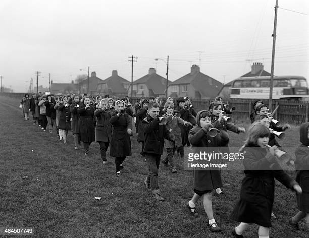 Children marching with home made bugles Middlesborough Teesside 1964 The photograph was taken for the National Coal Board for use in their Coal...