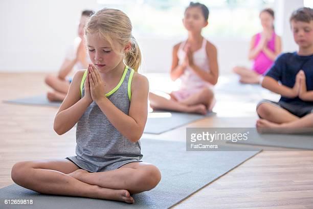 Children Meditating in a Yoga Class