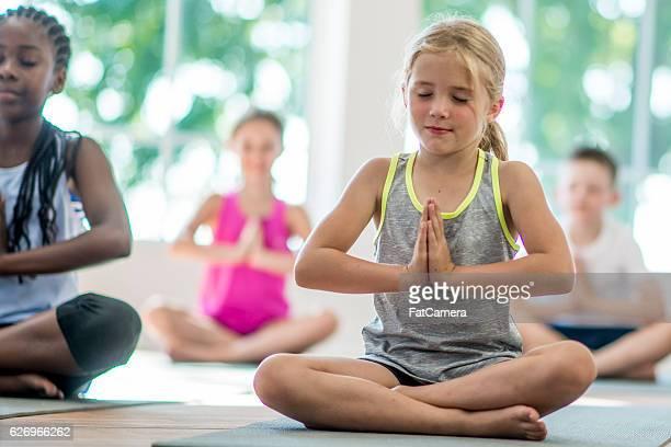 Children Meditating Together