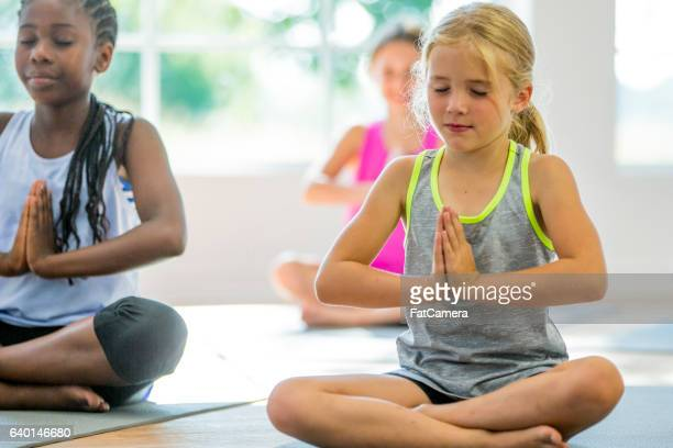 Children Meditating with Their Eyes Closed