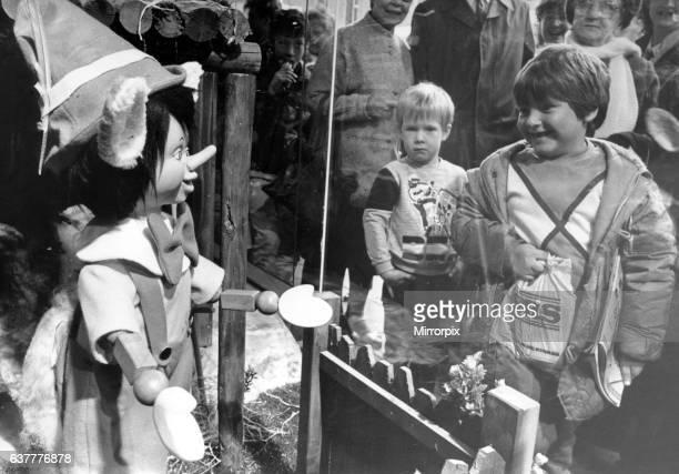 Children meet Pinocchio through the window of the Fenwick store in Newcastle. 9th November 1985.
