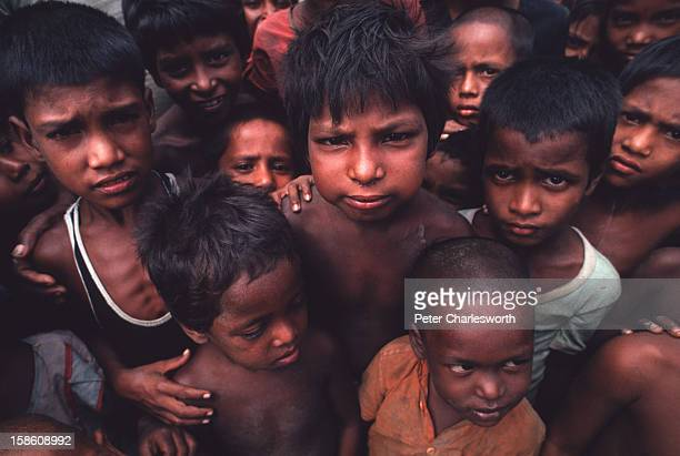 Children mill about looking dazed and confused after surviving one of the biggest cyclones to hit Bangladesh in recent decades Thousands of people...