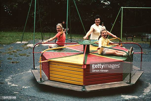 children & mother on roundabout - old fashioned stock pictures, royalty-free photos & images
