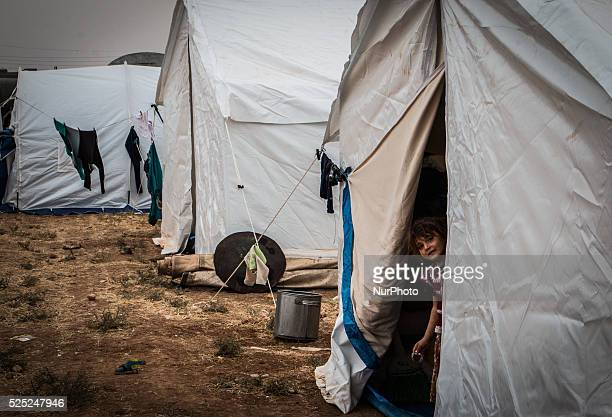 Children near a tents housing displaced Syrians in a camp on the southern outskirts of the northern Syrian city of Aleppo on October 22, 2015. Tens...