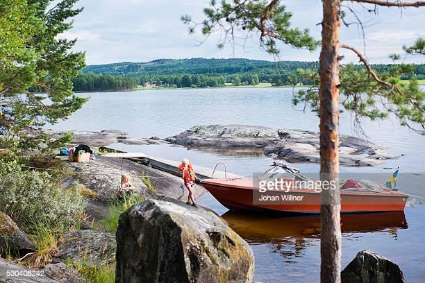 Children near boat, Siljan, Dalarna, Sweden