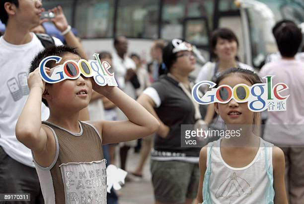 Children observe a total solar eclipse with Google goggles in Wangfujing Street on July 22 2009 in Beijing China The longest total eclipse of the sun...