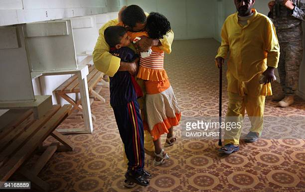 Children of an Iraqi detainee embrace their father during visitation at the Camp Bucca detention centre located near the KuwaitIraq border on May 20...