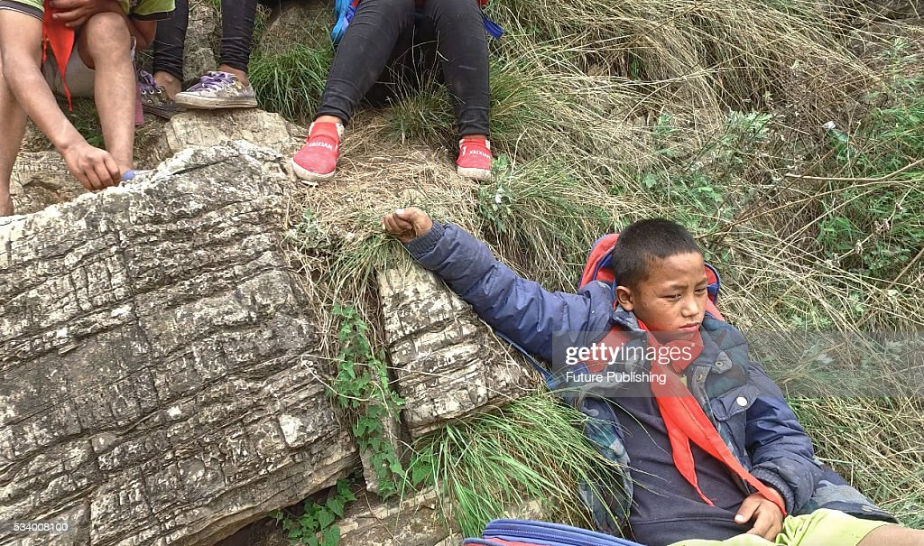 Children From Remote Chinese Village Climb Unsecured Vine Ladders On A Vertical Cliff : News Photo