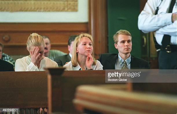 Children of Dr Dirk Greineder Britt Kirsten and Colin sit in the courtroom as their father accused of murdering his wife and their mother is...