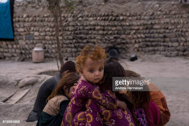 Children of families displaced by the Islamic State of Iraq and Syria Khorasan play at their current home on July 14 in Surkh Rod District...